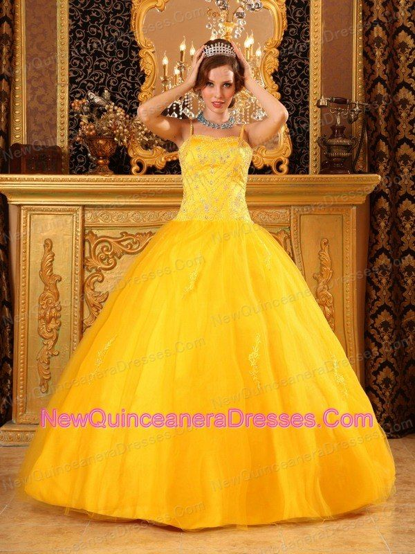 Yellow and white quinceanera dresses