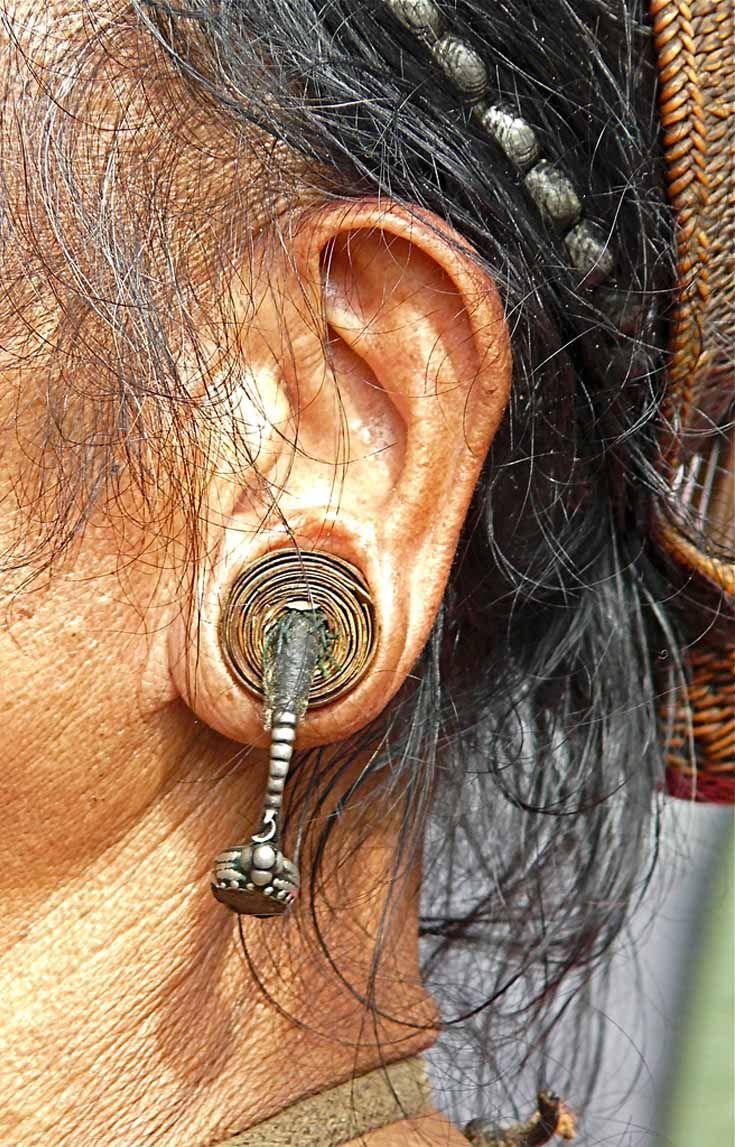 India - Assam, Arunachal Pradesh | Details for the earrings worn by a Nishi man | ©Rita Willaert