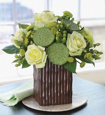 flower centerpiece with lotus pods