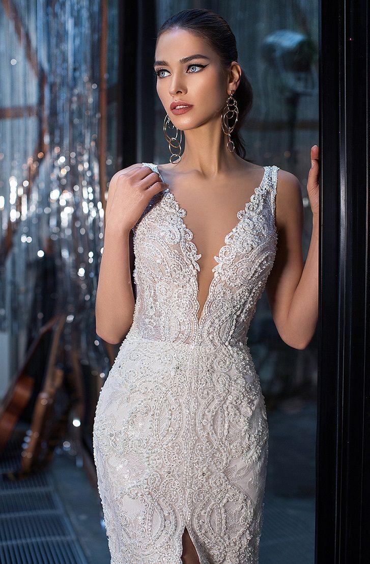 Sleeveless deep v-neckline and gorgeous embellishment made of beads, pearls and rhinestones Fit and flare wedding dress detachable train #wedding #weddingdress #weddinggown