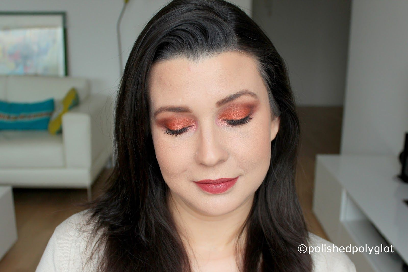 Makeup look in rusty brown and orange, described in English and ...