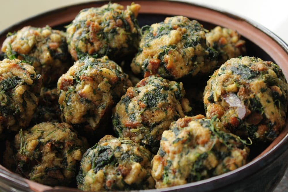 Spinach Stuffing Balls are easy to make ahead of time and warm up in a jiffy while the turkey is being carved. It's one of our family's favourite holiday side dishes. #stuffingballs #sides #Thanksgiving #ChristmasDinner #Dinner #SpinachStuffingBalls
