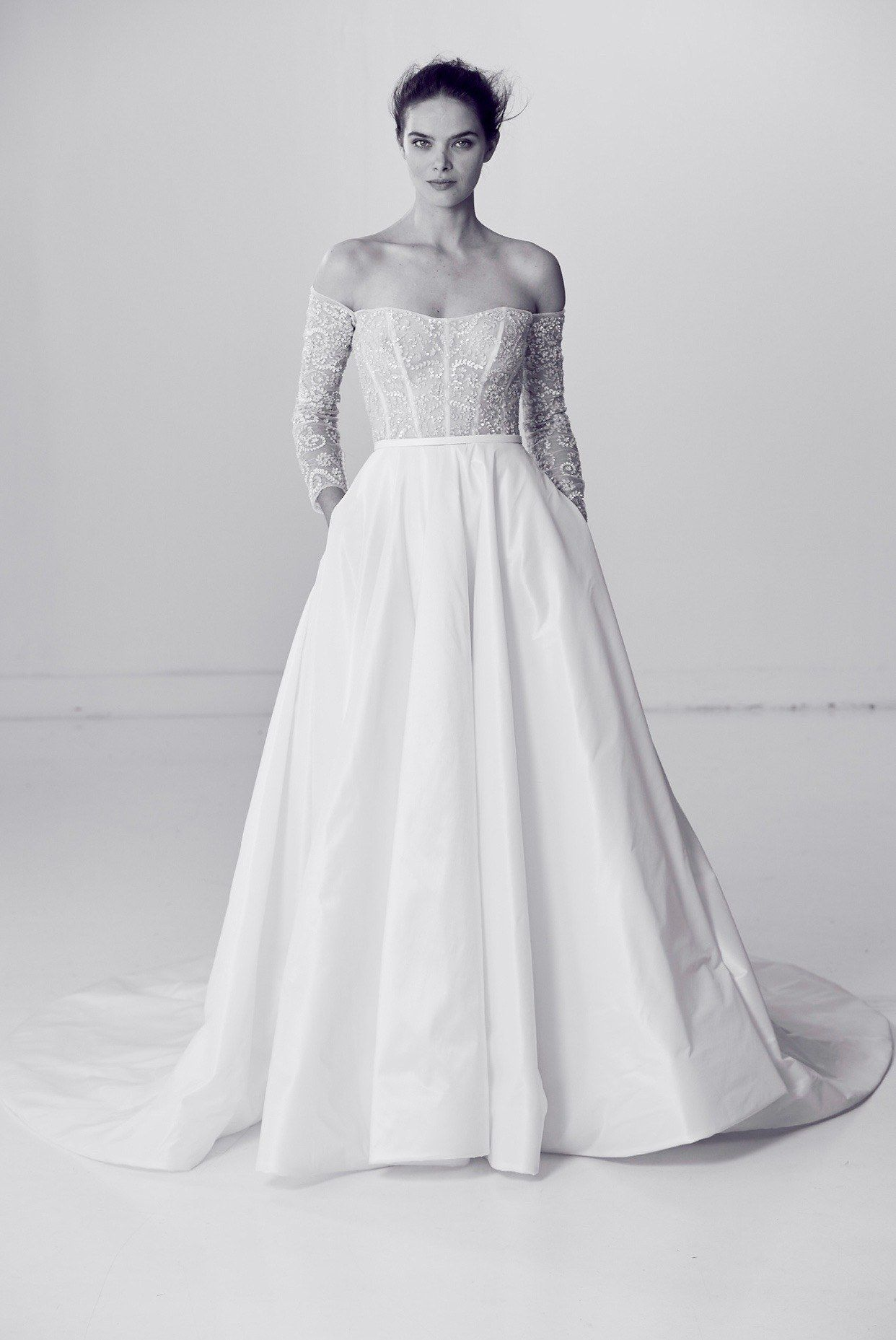 """Alyne by Rita Vinieris's """"Perfect"""" dress from the spring 2018 collection is a taffeta ball gown in a full floor-length with a portrait collar sheer beaded bodice and long sleeves."""