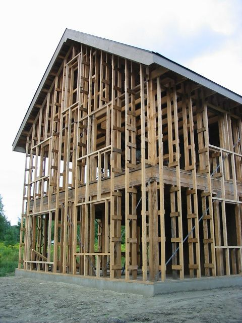 P The Walls Are Framed With 12 In Thick Modified Larsen Trusses The House Has No Wall Sheathi Roof Truss Design Timber Frame Construction House In The Woods