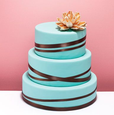 Try White Cake With Vrown And Turquoise Ribbons Babys Breath Flowers On Top