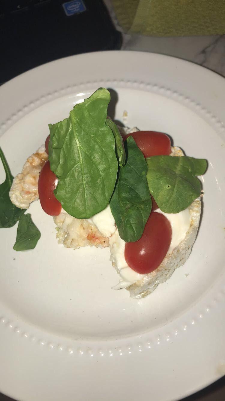 Light meal mozzarella tomatoes basil on rice cake