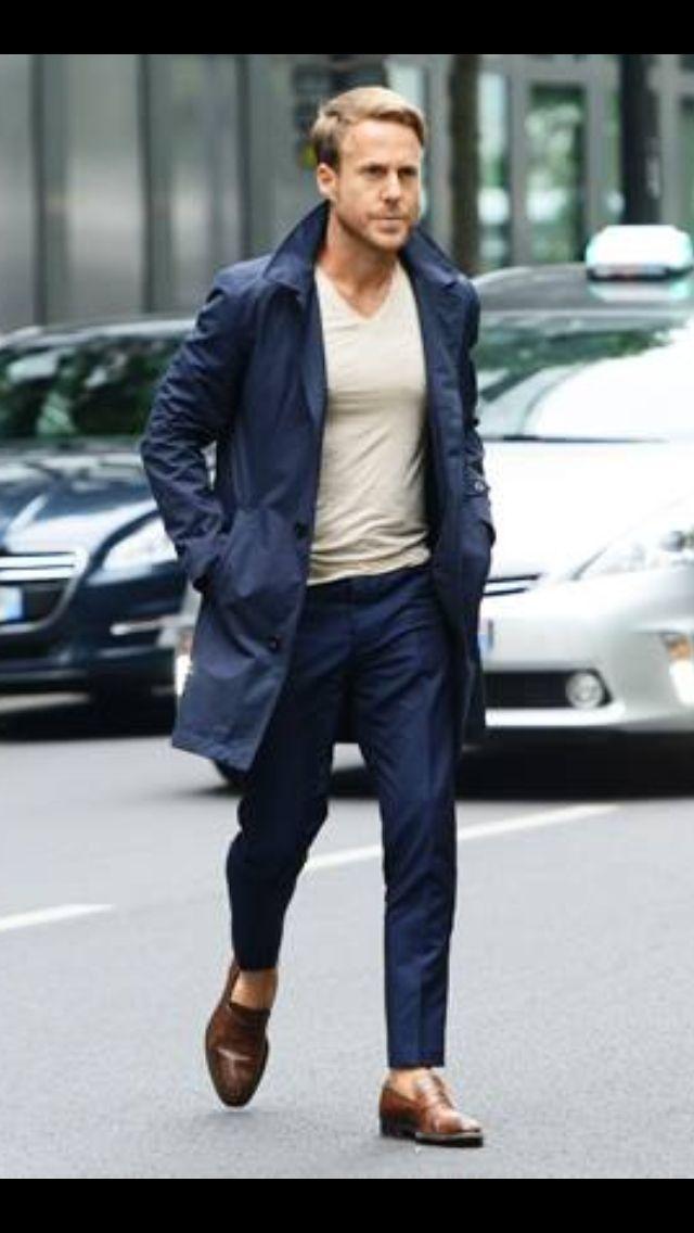 Blue overcoat, v-neck shirt, blue dress pants, sockless ...
