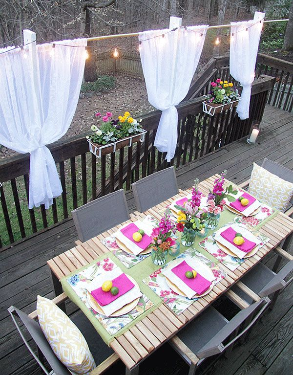 Backyard deck ideas with dining set and window boxes for Decorated decks and patios