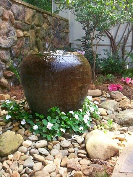 Bubbling fountain pot pot fountains lawn garden for Pot water feature ideas