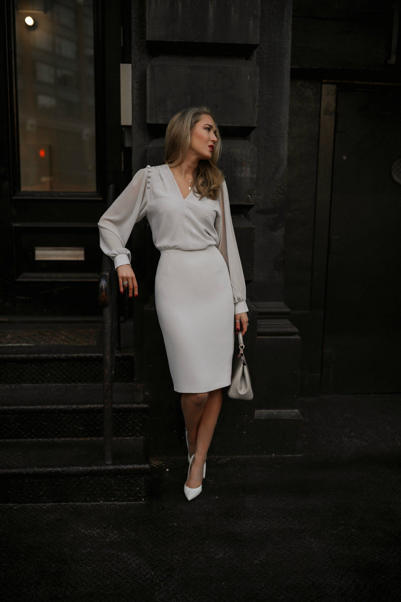 5fa2aec4db NYC style blogger in Reiss dress on city sidewalk wearing pumps and Dolce    Gabbana bag