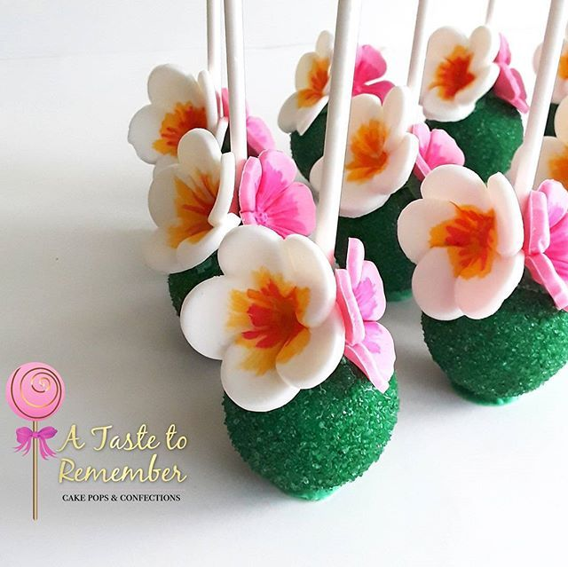hawaiian style floral cake pops for a moana cake pop set design borrowed from. Black Bedroom Furniture Sets. Home Design Ideas