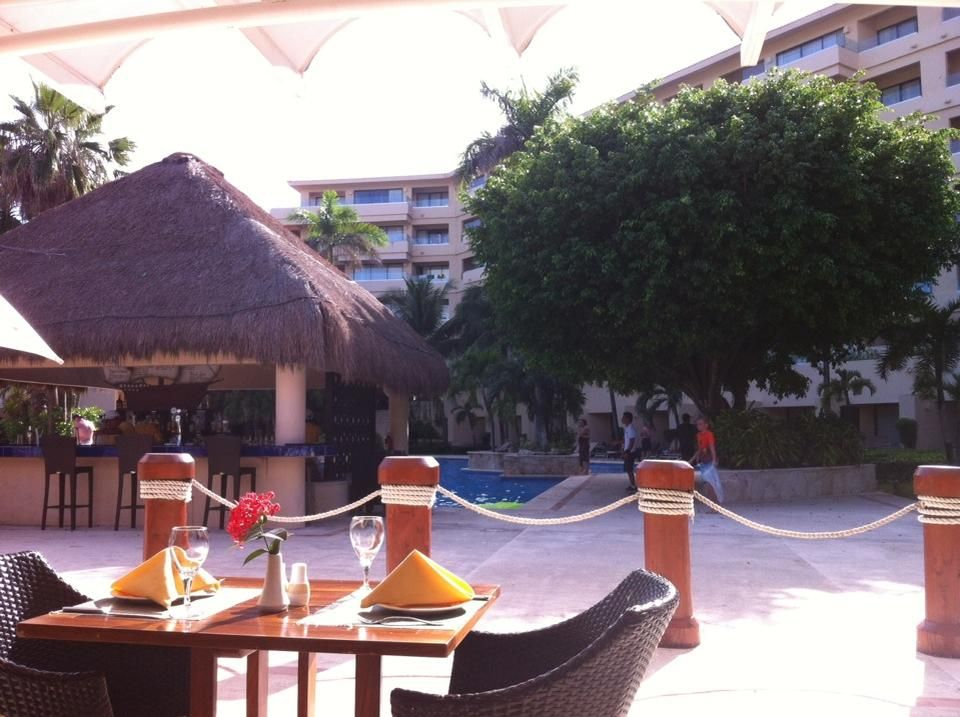 Dreams Puerto Aventuras Resort & Spa - Pool view from the Seaside Grill. Photo shared by Jose Luis D.