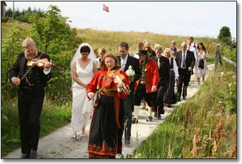 Norwegian Wedding Traditions. Bride, groom, and family led into ceremony with fiddlers.