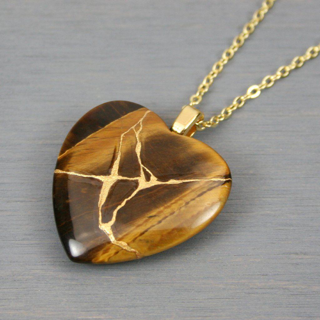 Tiger eye broken heart pendant with kintsugi repair on