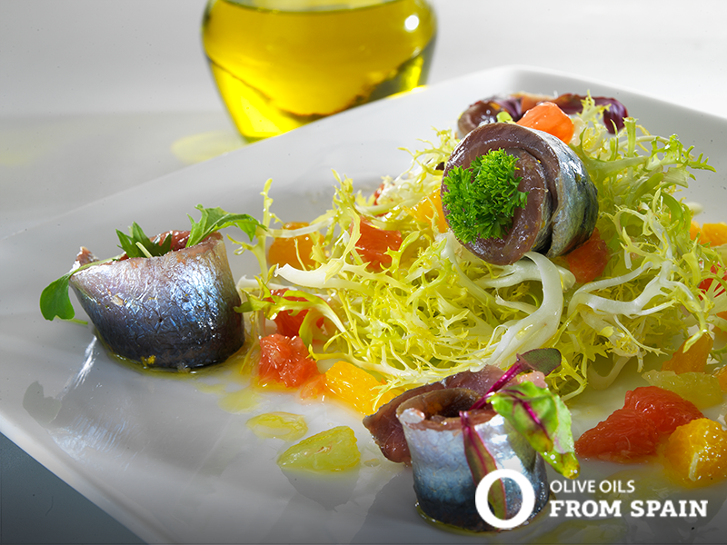 Marinated Sardine Salad in a Citrus Dressing made with Olive Oils from Spain - Bright, delicious and nutritious, toss together this salad when you're hungry for both seafood and veg! #TrendingFoods #sardines #salads #Omega3s