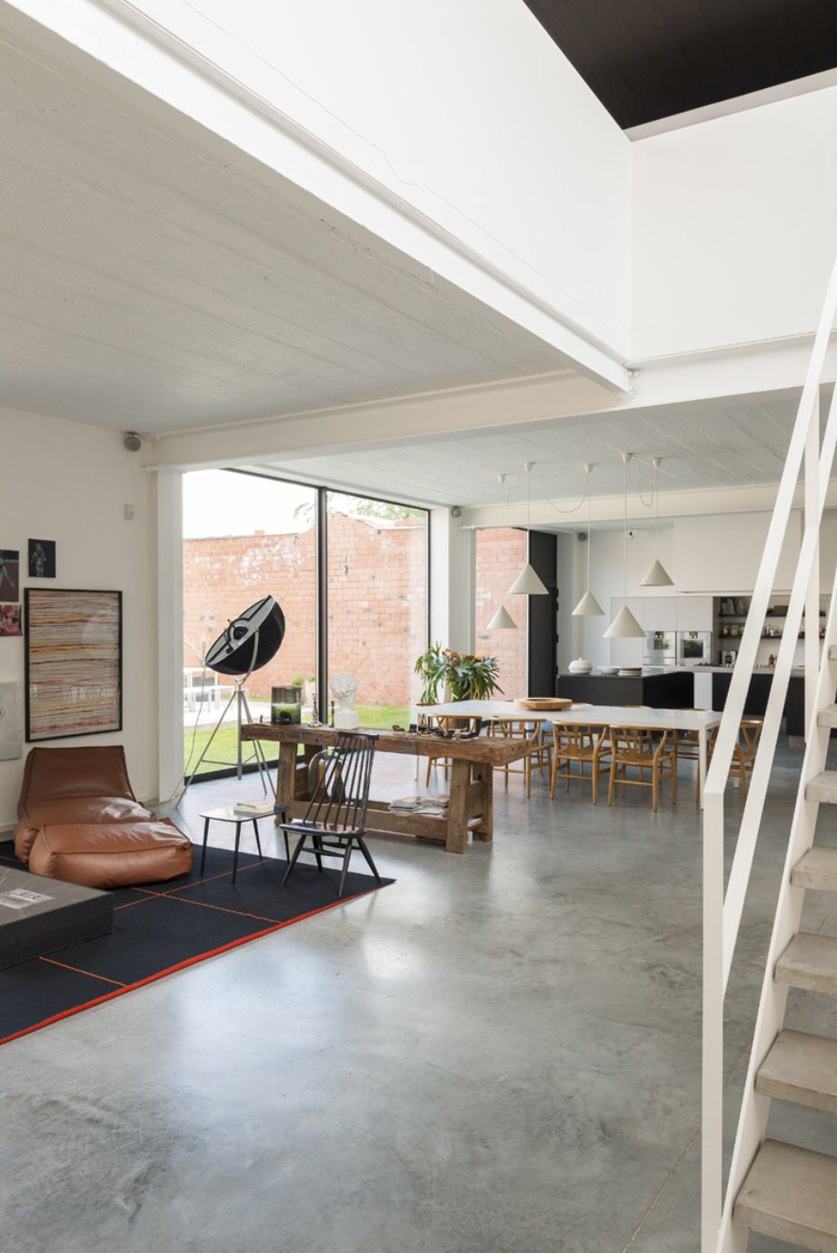Concrete floors white walls wood browns furniture for - Concrete floors in house ...