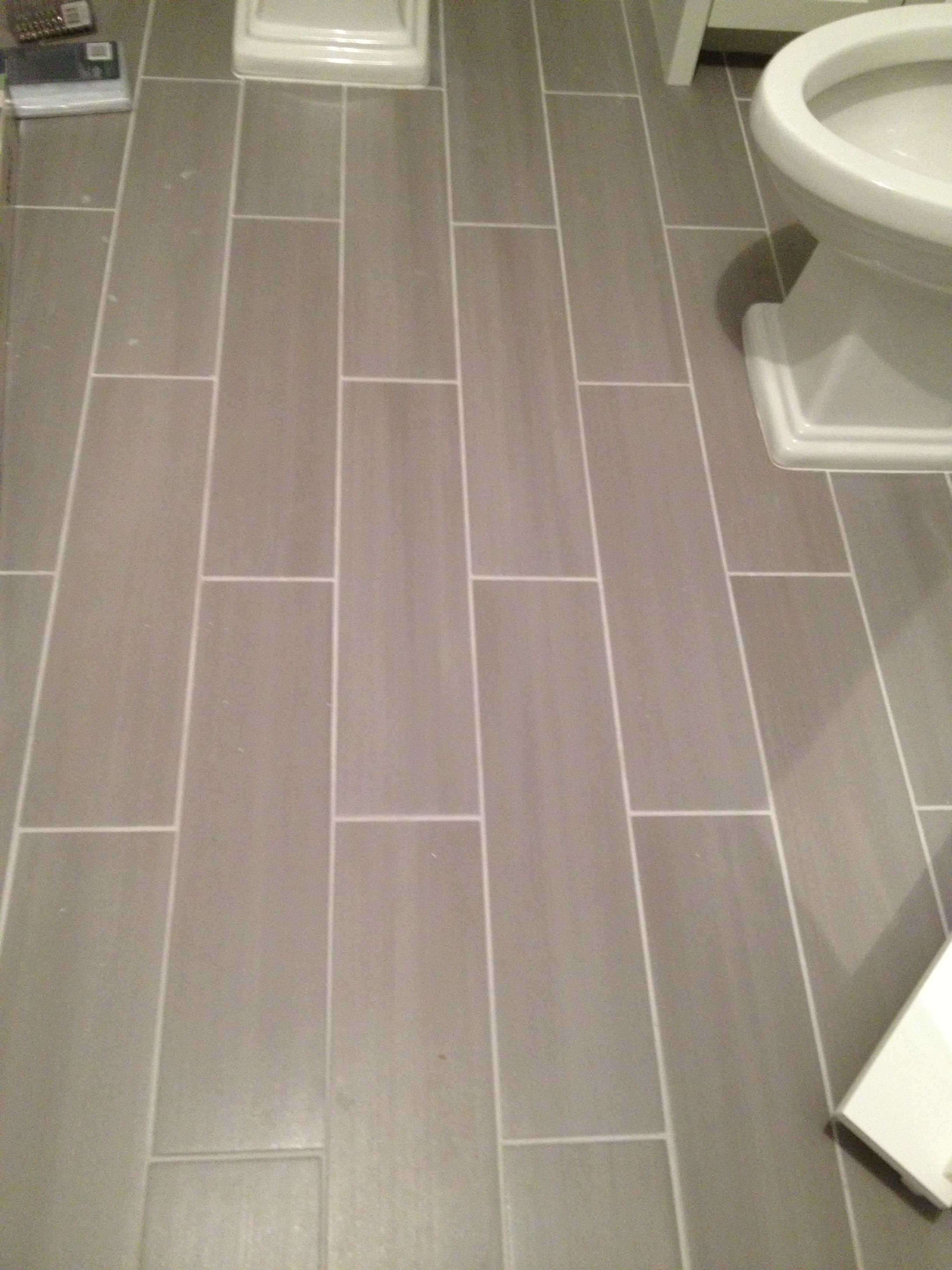 Guest bath plank style floor tiles in gray sarah bernardy guest bath plank style floor tiles in gray dailygadgetfo Gallery
