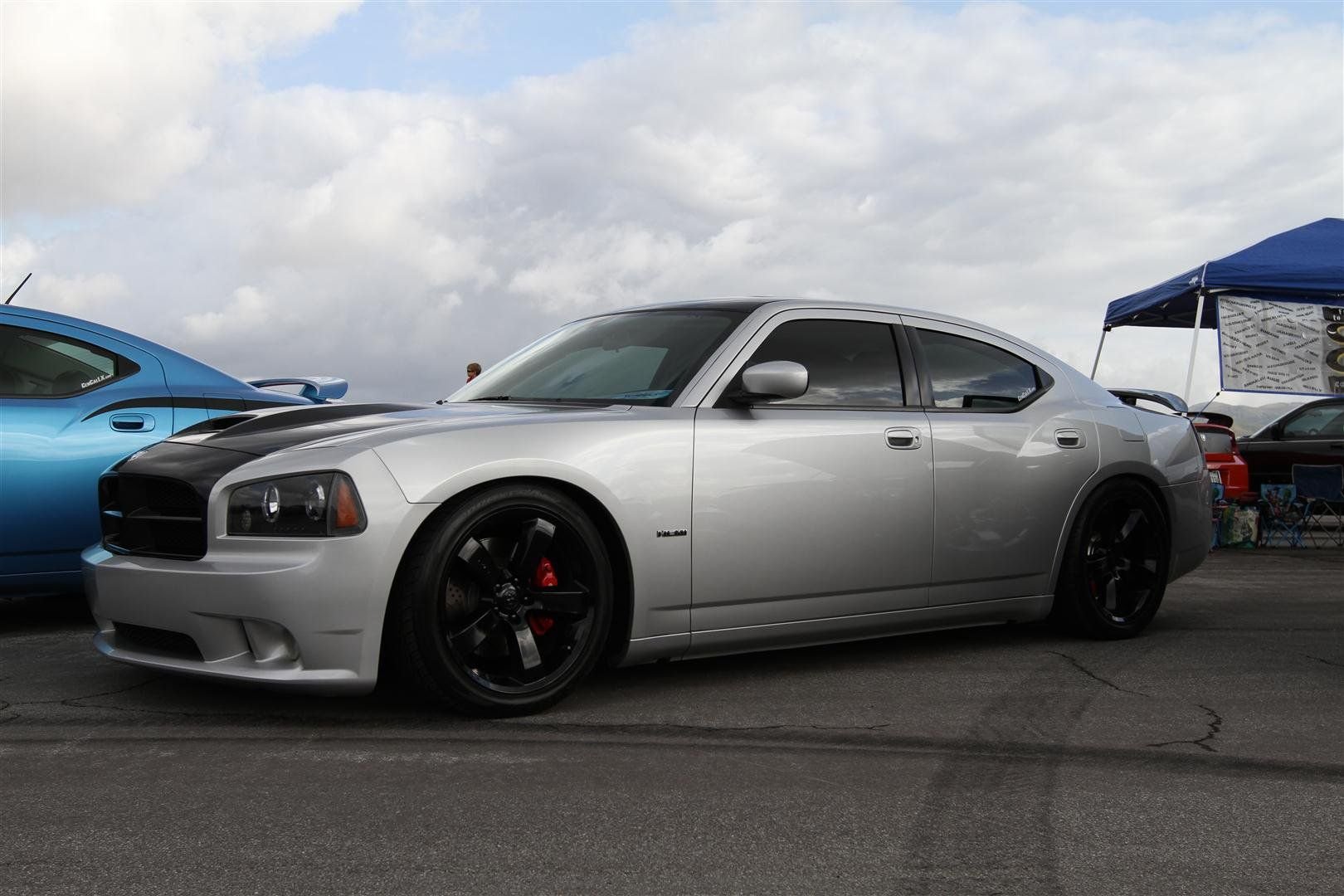 Dodge Charger Srt Black Chrome Rims With Red Calipers It S A Fight Between These And The Dodge Viper Rims Dodge Charger Srt Dodge Charger Dodge Viper