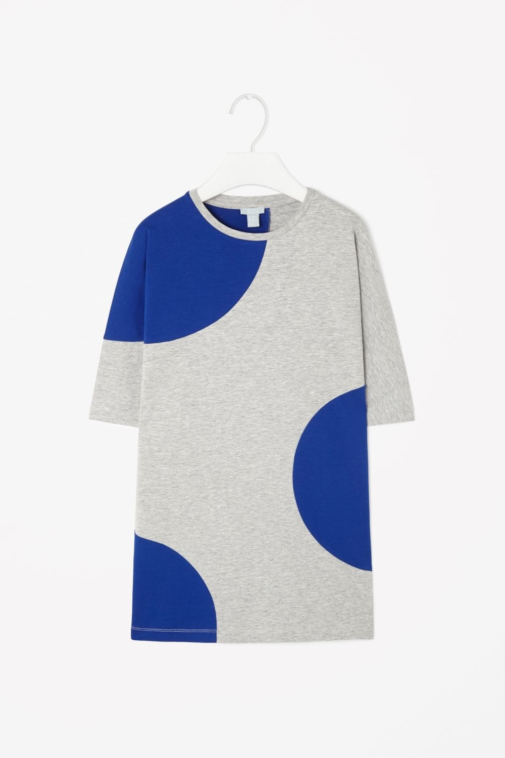This long jersey dress has circleshape panels in bold block colour