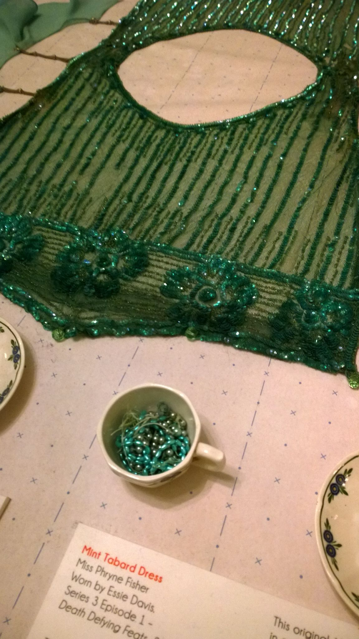 860748921e99 Beading detail on Miss Fisher s mint tabard dress. This was probably my  favourite dress from season 3  worn by Phryne during Jack s drunken speech  in  Death ...