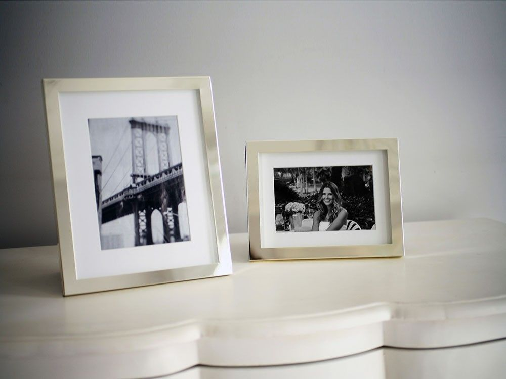 Stylish silver-plated photo frames with elegant, contemporary matte white mount.  Measurements correspond to photo size. Price £0.00