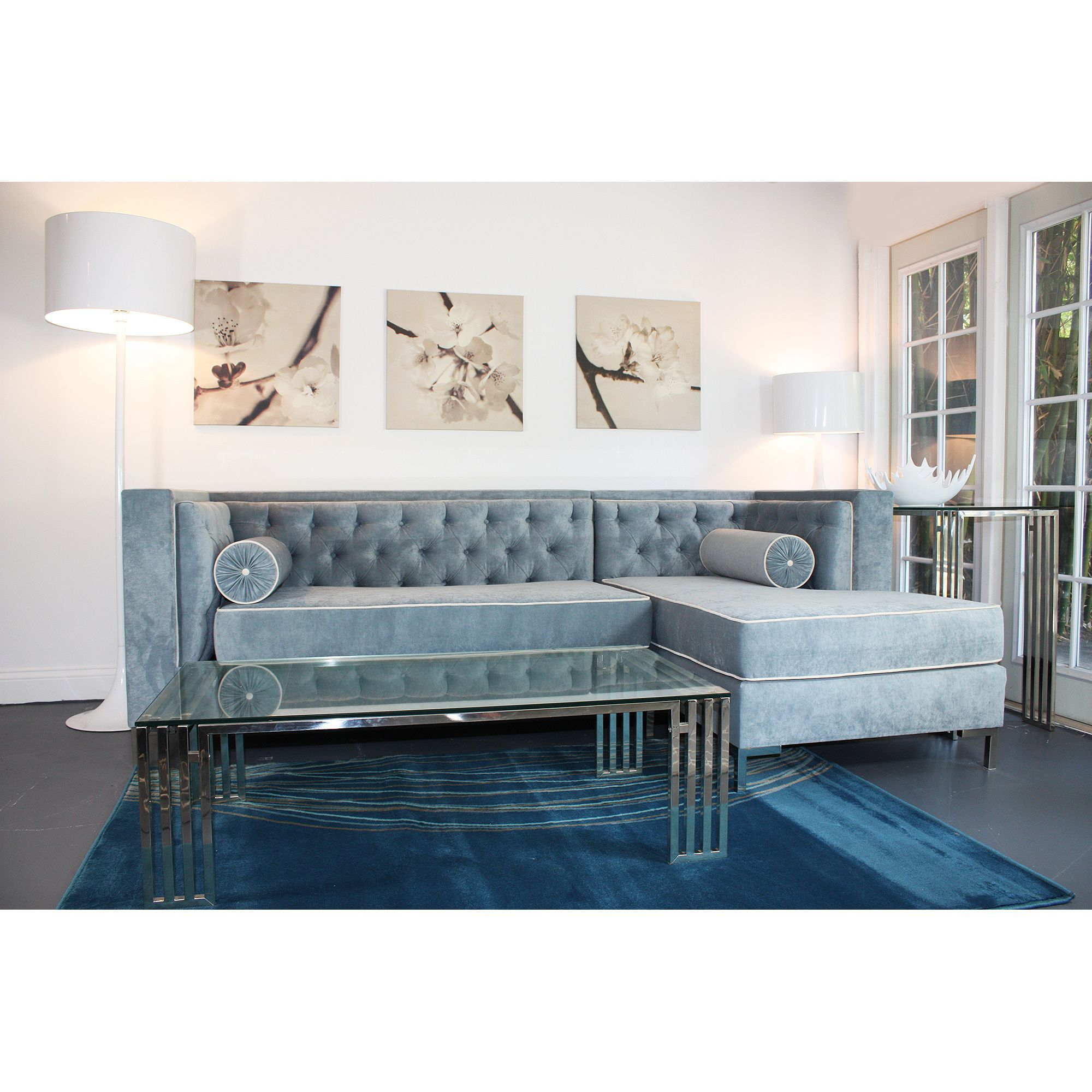 The Tobias lush hand tufted sectional sofa features Wedgewood blue