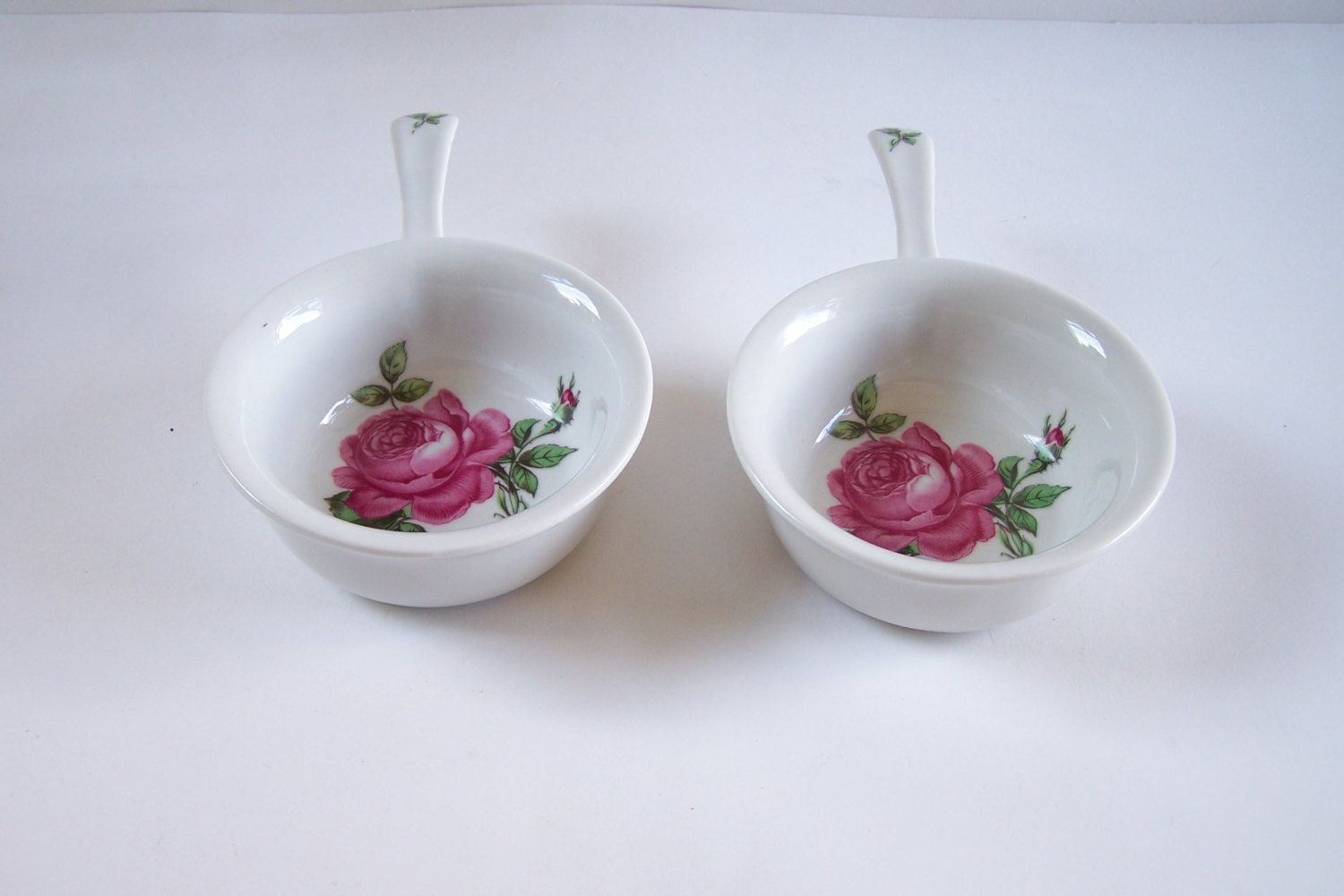 Pair of dish pink rose pattern Singer porcelain from