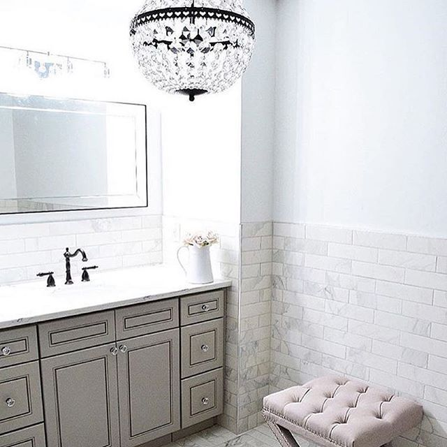 Classic design in this bathroom from @monicamariedesign sets off our Mia chandelier.  After this weekend, we think everyone needs a little moment of beauty in their lives to regroup.  Here is to having a good Monday! #mypotterybarn