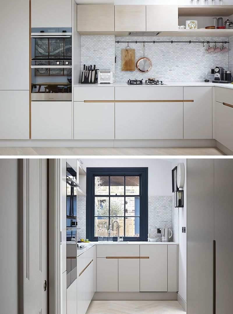 This Kitchen Has White Melamine Cabinets With A Recessed Finger Detail M Kitchen Cabinet Design Kitchen Cabinets Without Hardware Modern White Kitchen Cabinets