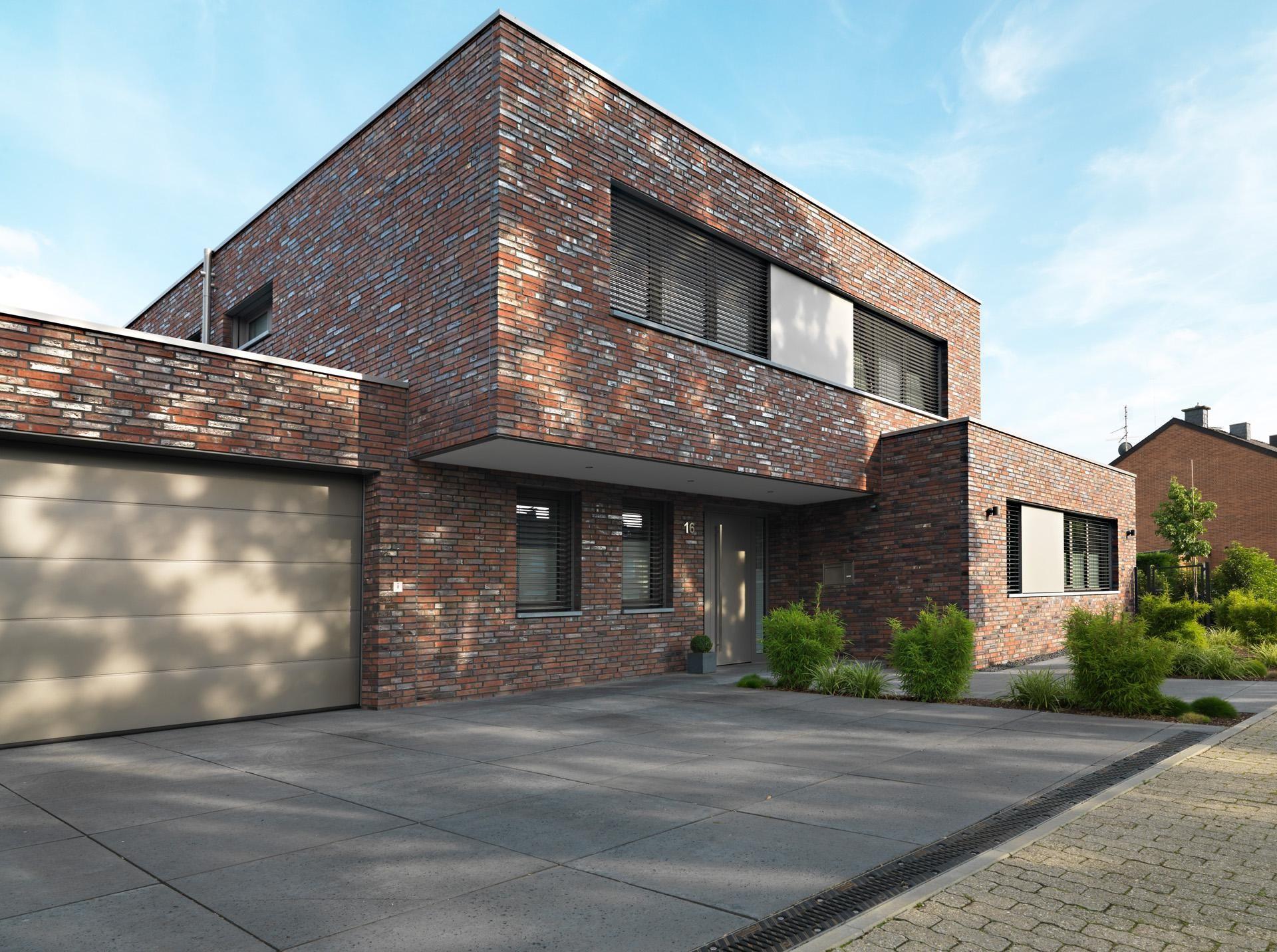 Moderne wohnarchitektur ein dunkler ringofenklinker mit besonderer oberflächenstruktur durch