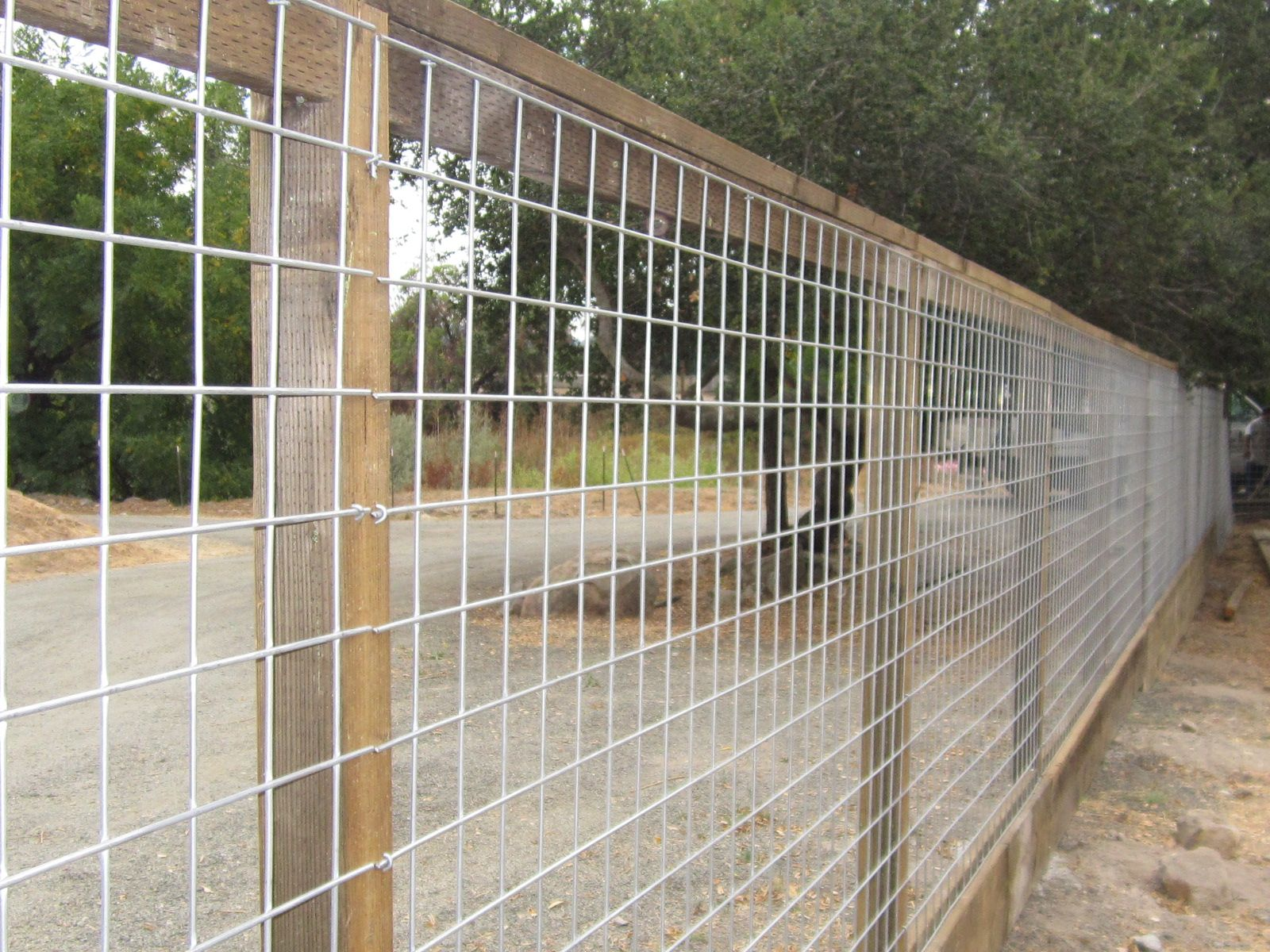 4x4 Hog Panel mesh on 4x4 posts and kickboard by Arbor Fence, Inc ...