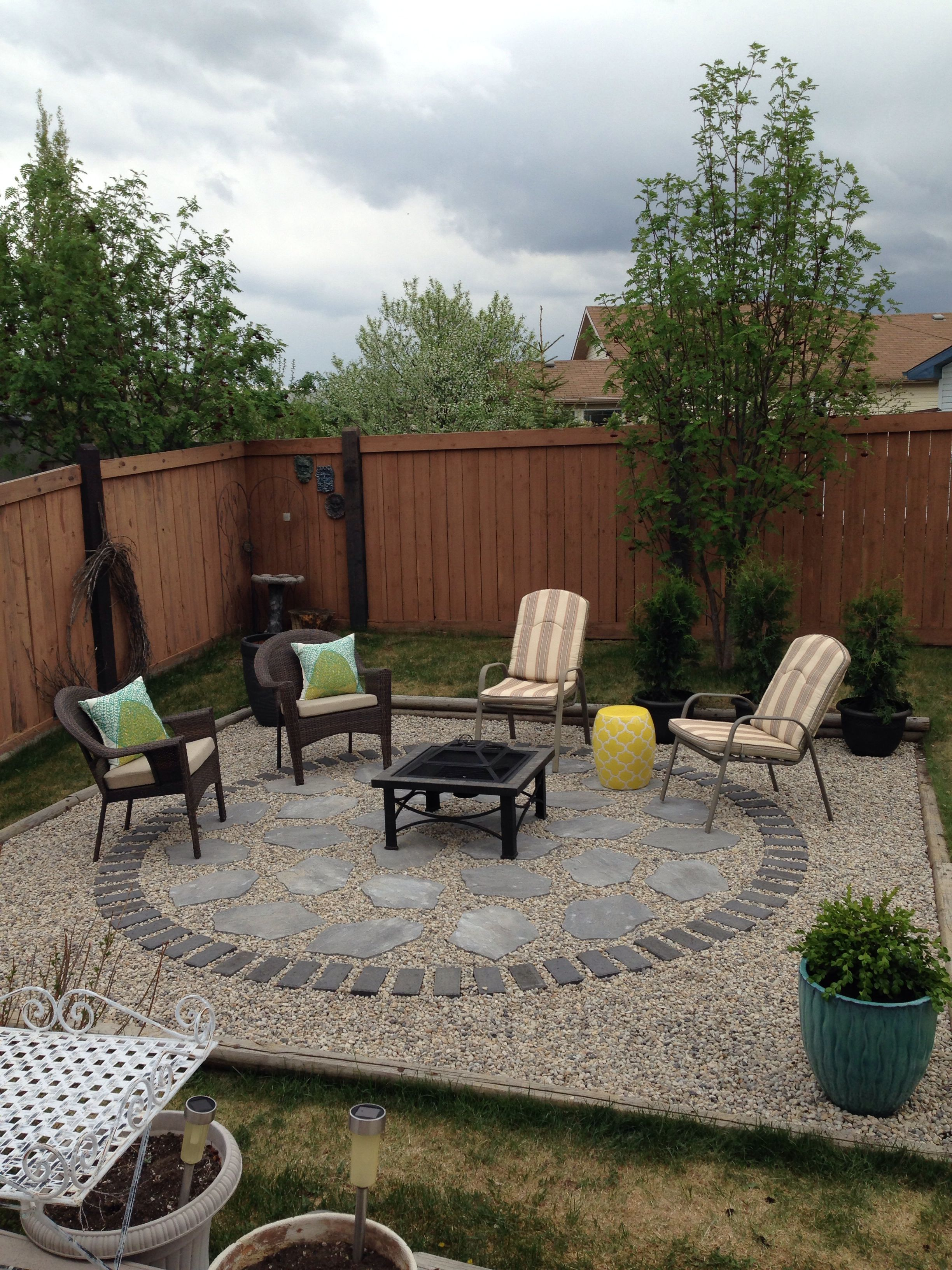 gravel and stone fire pit patio backyard landscaping on backyard fire pit landscaping id=47335