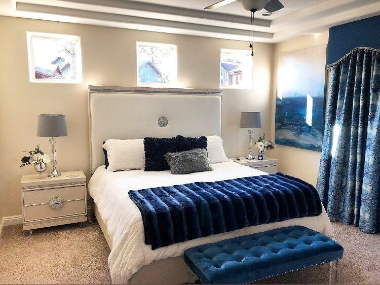 We love this bedroom with its beautiful pops of blue ...