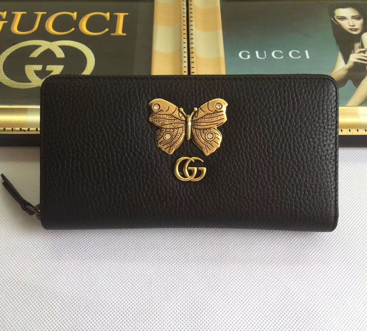 Gucci black leather zip around wallet with butterfly zip