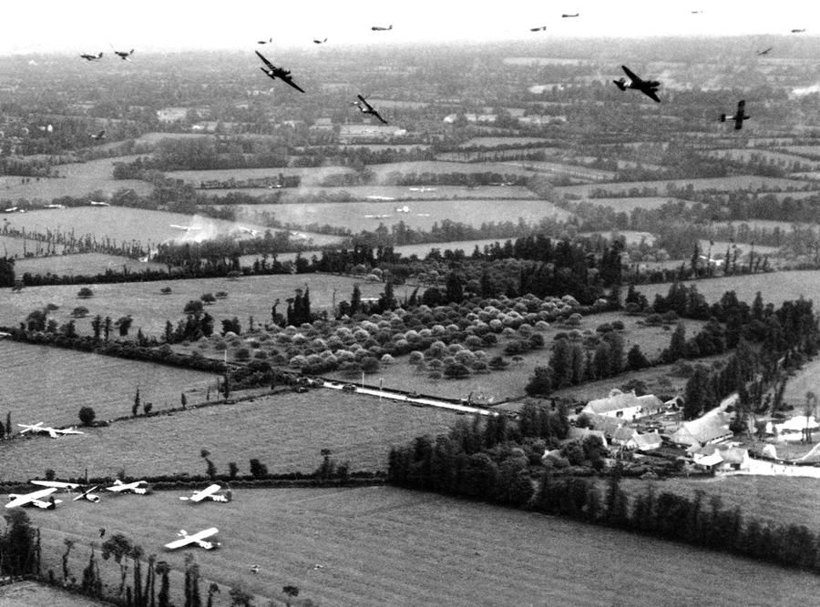 Tow planes and gliders above the French countryside during the ...