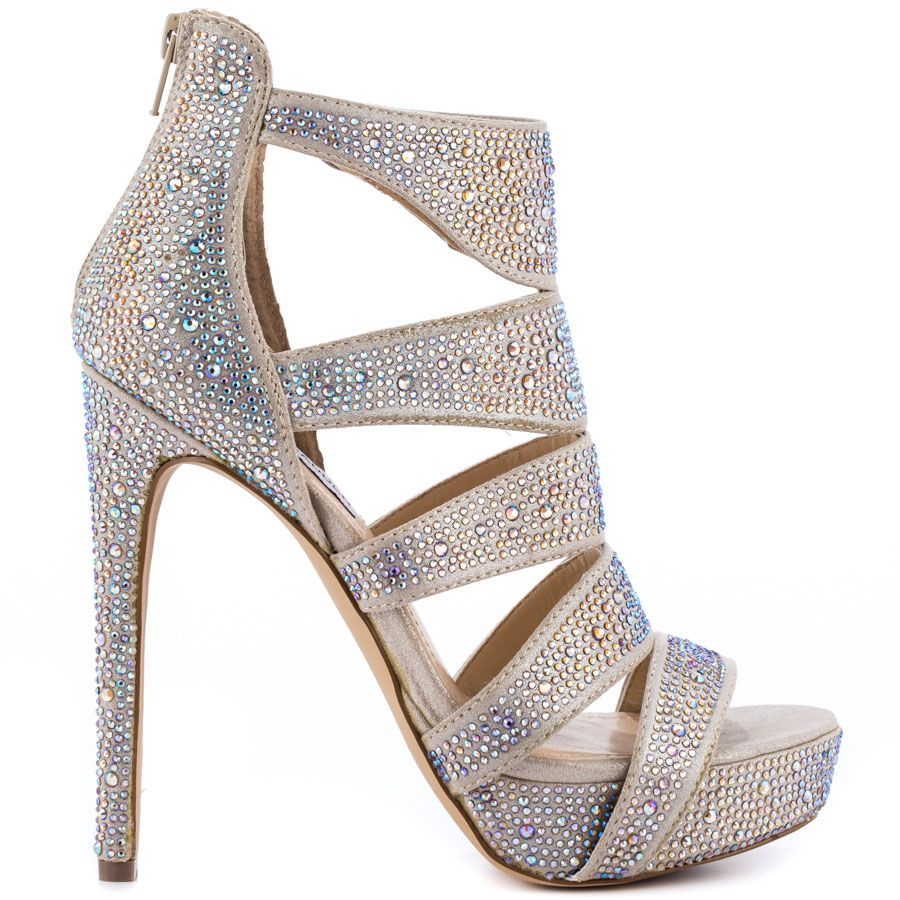 Feel the heat in the Spycee by Steve Madden. This hot sandal delivers a  champagne