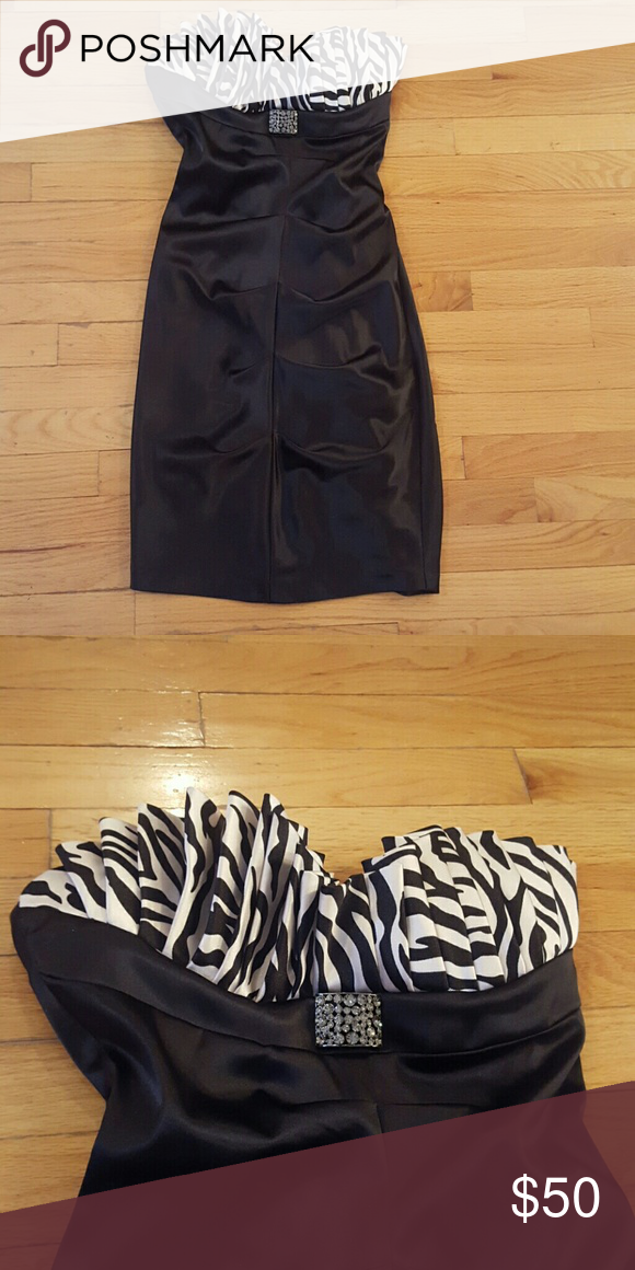 Formal black dress Great condition from Lord N taylor.  Black formal cocktail dress with zebra print top and a pin below zebra print. It is a small but runs tight Betsy & Adam Dresses Strapless