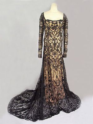 Hand-embroidered tulle gown, c.1912. Hand-appliquéd lace inserts and back train.