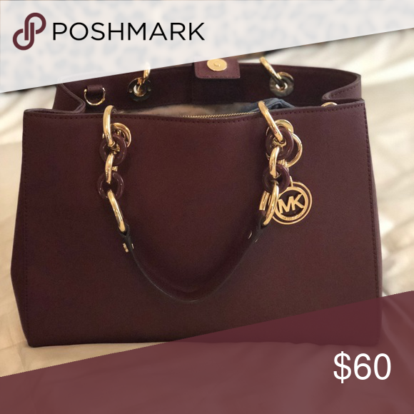 275e023f9 Michael Kors purse Michael Kors maroon colored purse with gold/maroon chain  handles Bags Totes