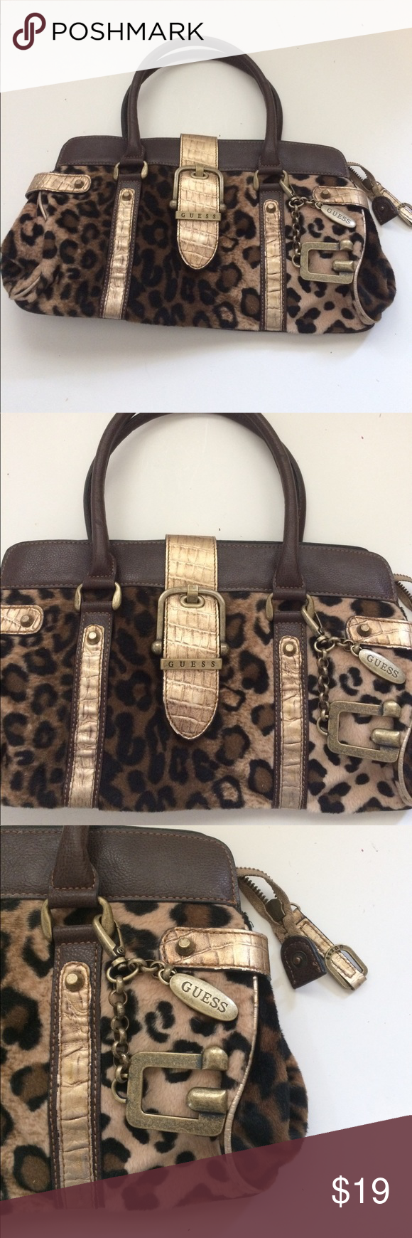 "Guess Fuzzy Cheetah Brown Gold Bag How fun is this bag?! Fuzzy Cheetah print bag. Metallic gold details. Vegan leather. Exterior and green lining in good used condition. Light wear. 14"" by 9"" All reasonable offers accepted. Guess Bags Satchels"