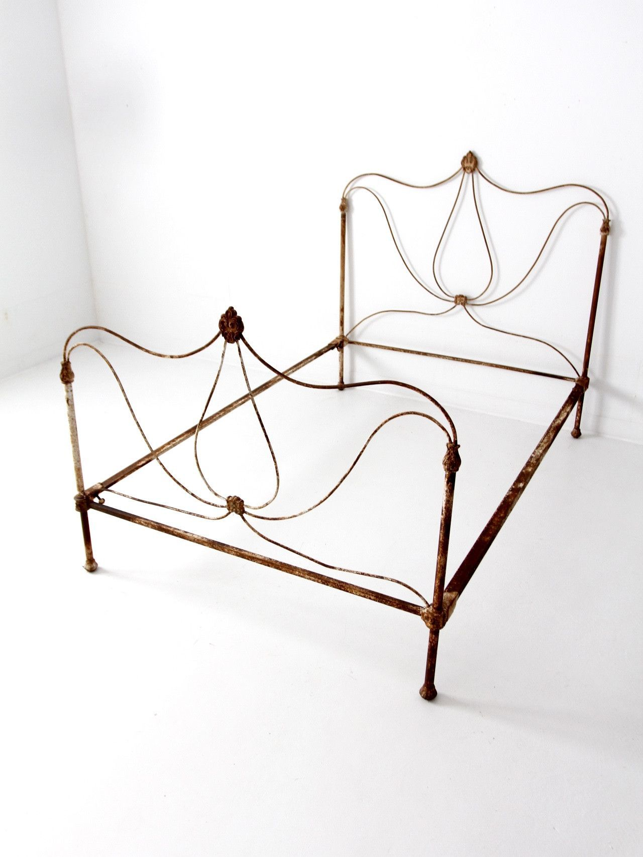 An Antique Iron Bed In The Art Nouveau Style A Double Size Bed Frame With Decorative Headboard Footboard And Angle Iron Bed Antique Iron Beds Iron Bed Frame