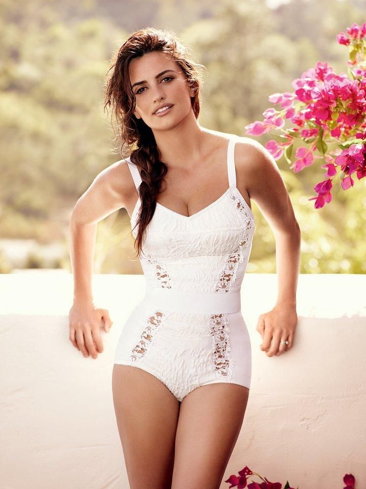 Penélope Cruz in a lace bathing suit and a messy side braid