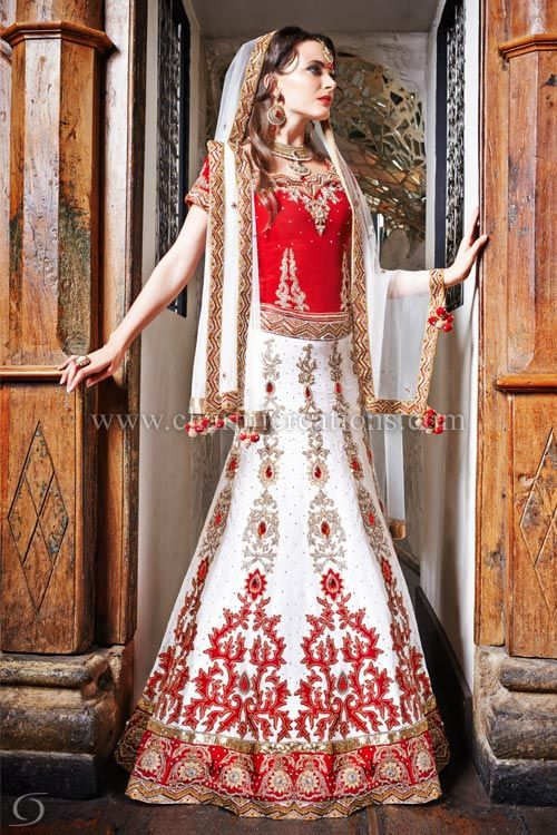82f5f92a7b Indian Bridal Wear - Indian bridal red and white lengha with 10 panelled  skirt and a red velvet blouse