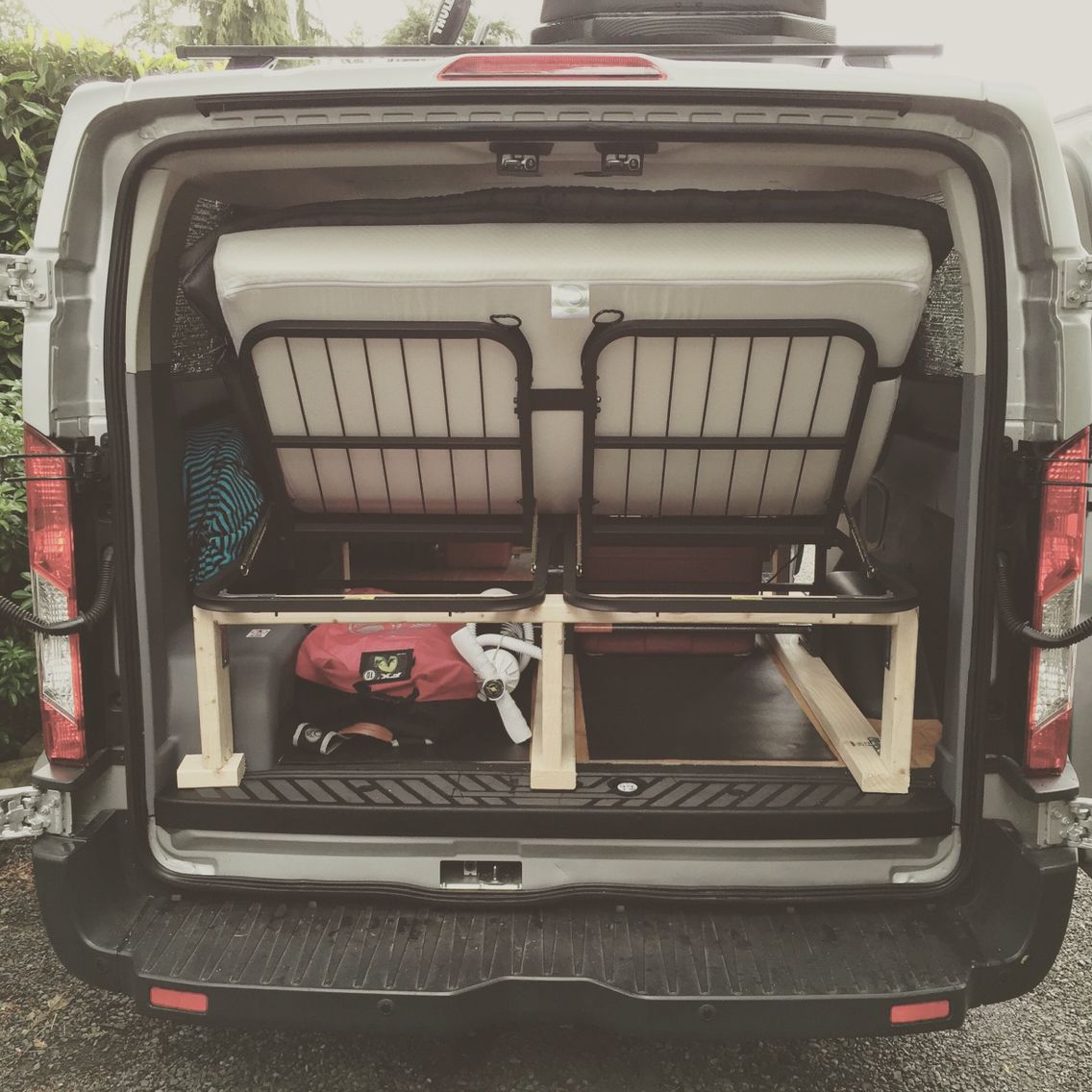 pragmabed adjustable full size bed installed in a ford transit camper conversion