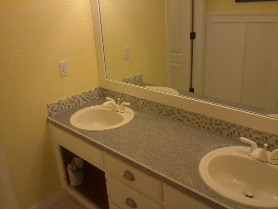 Bathroom Tile Countertop Ideas And Buying Guide: Pastel Wall Paint Bathroom  With Big Mirror Closed
