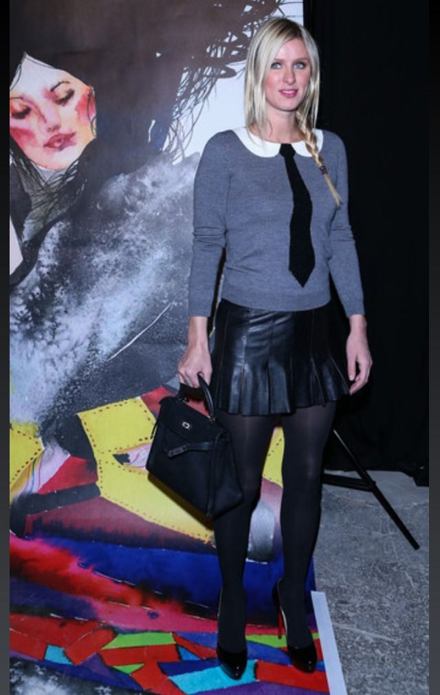 Nicky Hilton wearing Hermes Kelly Bag in Black Togo Leather Alice + Olivia Delray Sequin Tie Sweater