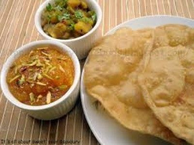 Halwa Poori Is One Of The Staple Foods Of Southeast Asia It Is A Traditional Indian Dish And Also A Part Indian Food Recipes Indian Breakfast Cooking Recipes