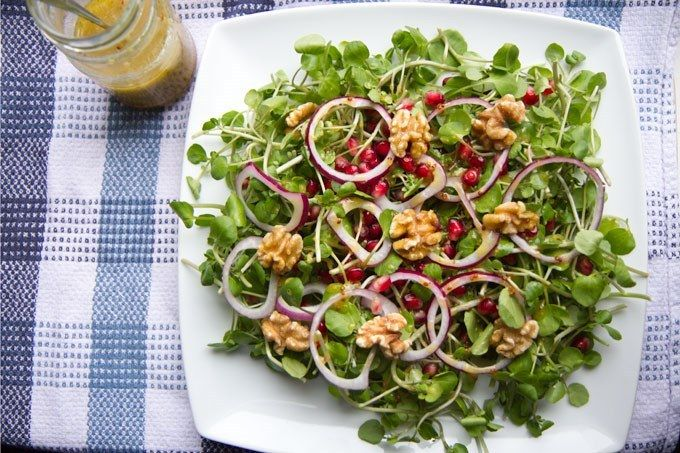 Watercress, pomegranate, red onion and walnut salad with a honey and mustard vinaigrette.