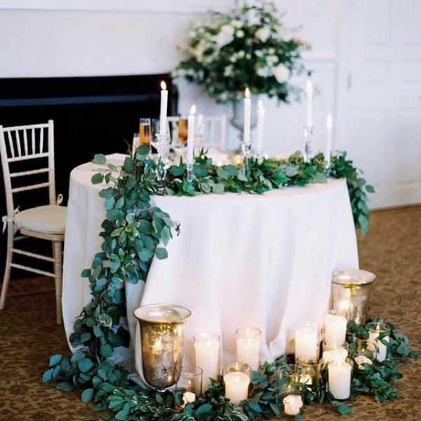 Sweetheart Table with Greenery  Wedding couple table decoration