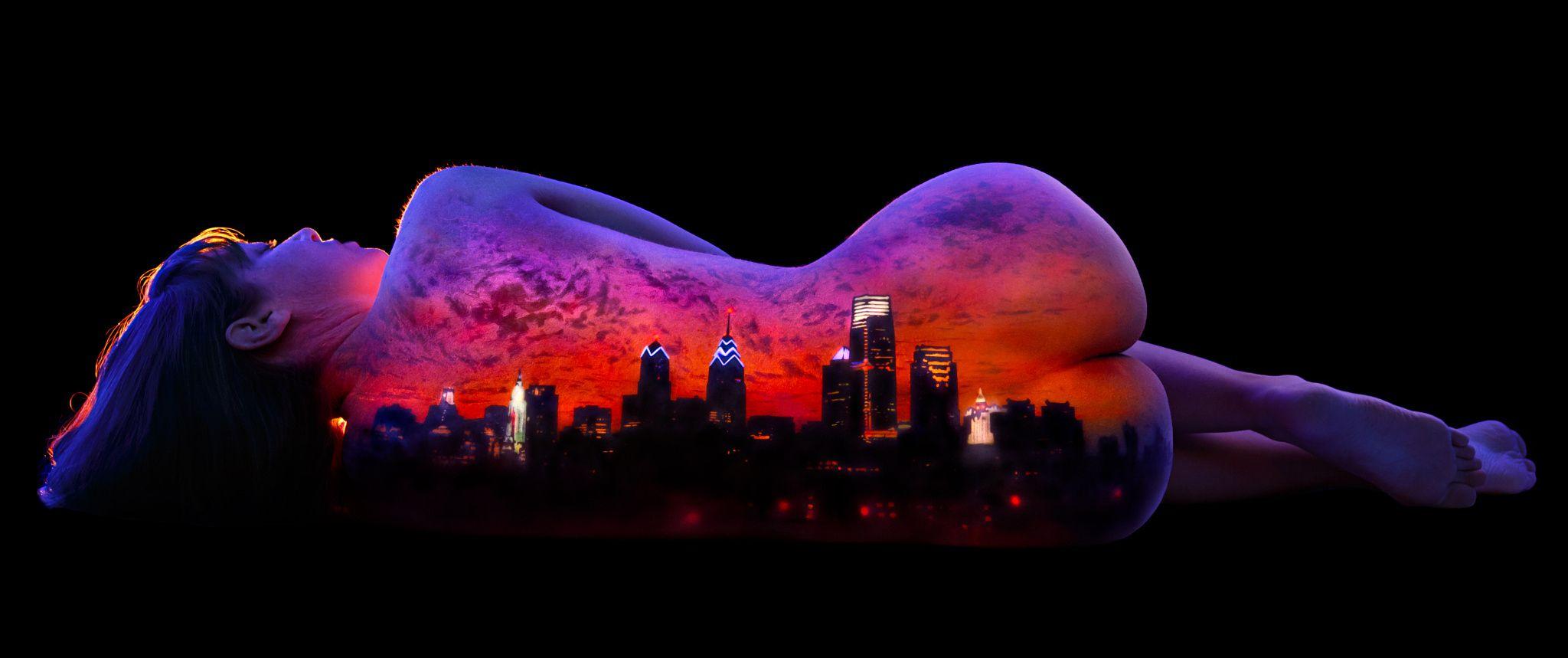 The Philadelphia Skyline Painted On The Back Of A Woman Using UV - Amazing black light body art photography john poppleton